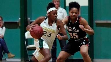 Longwood's Taedra Simpson (23) drives against Hills East's