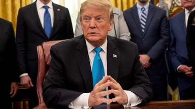 President Donald Trump attends a White House signing