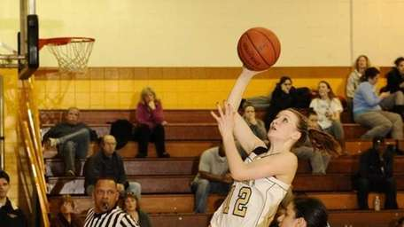 St. Anthony's Rebecca Musgrove goes up for a