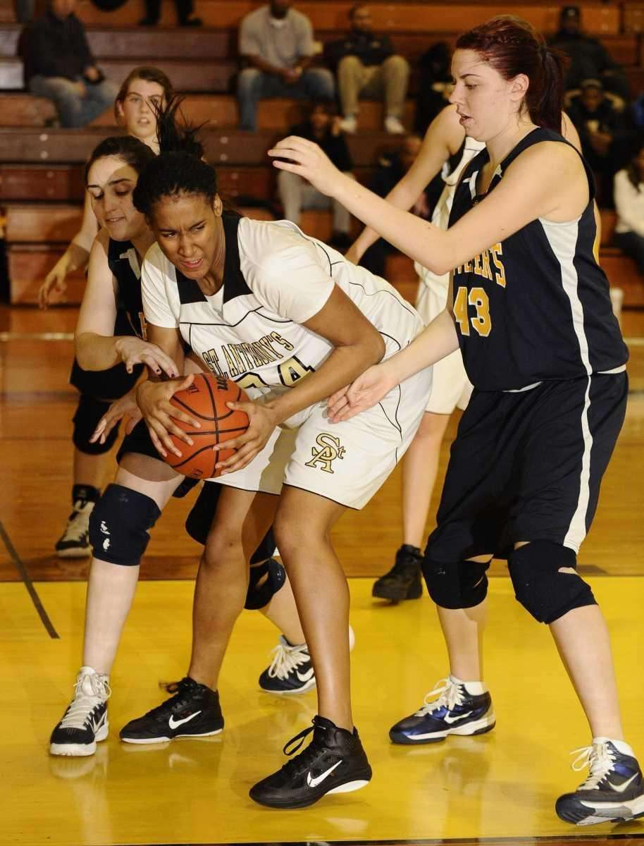 St. Anthony's Symone Kelly controls the ball guarded