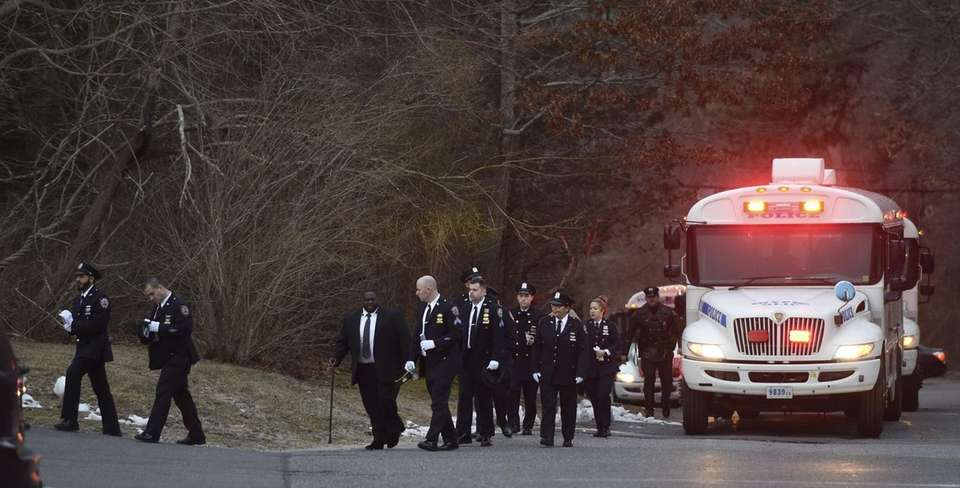 Police arrive for the funeral of NYPD Det.