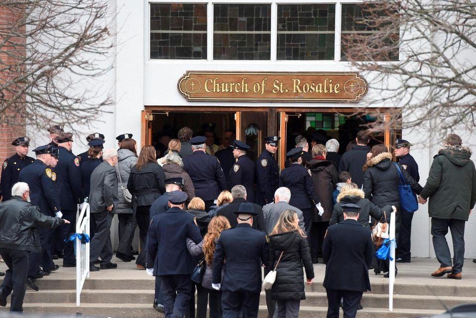 People walk into Church of St. Rosalie Church