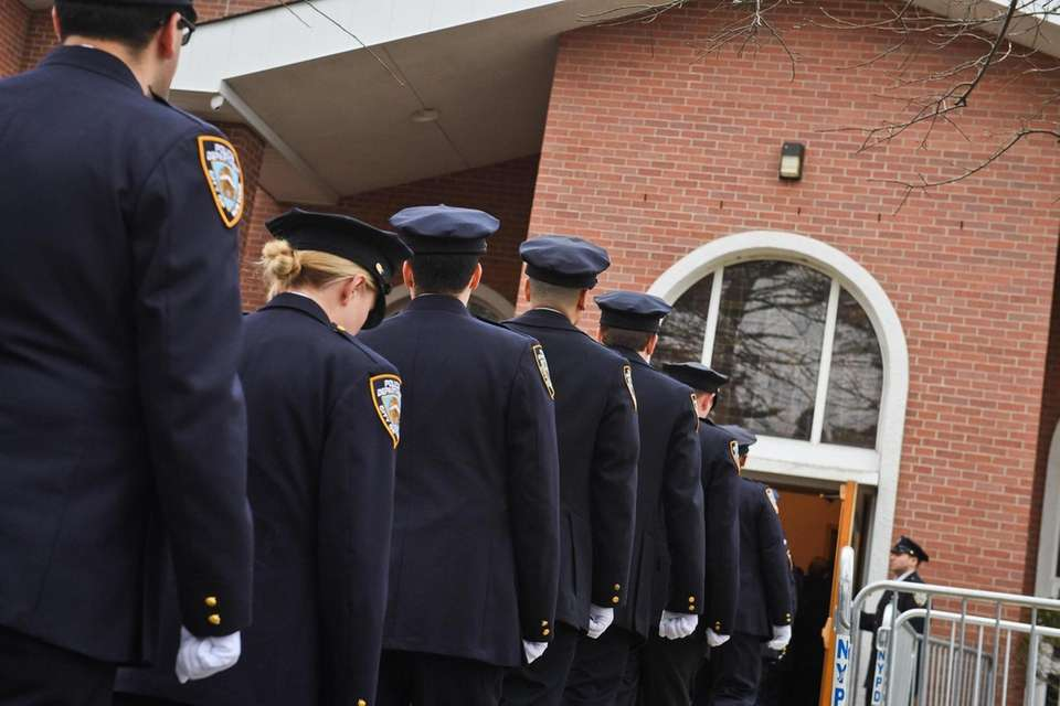 NYPD officers attend the funeral for Det. Brian