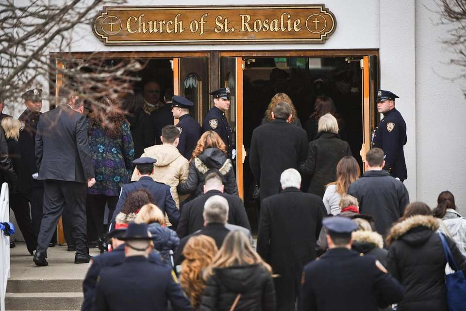Crowds file into the funeral for NYPD Det.
