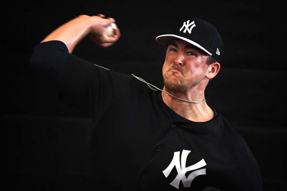 New York Yankees Pitcher Jonathan Holder throws a
