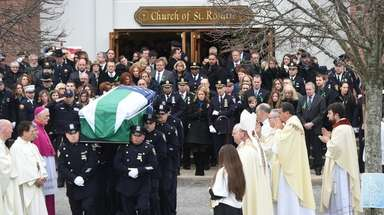 NYPD Det. Brian Simonsen's casket leaves the Church