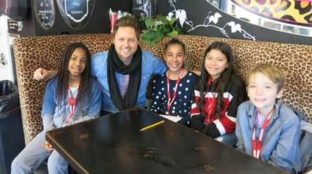Singer Nick Howard with Kidsday reporters, from left,