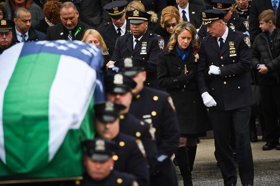 NYPD Officers carry the casket of Brian Simonsen