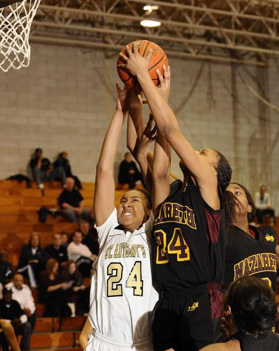 St. Anthony's Symone Kelly fights for a rebound