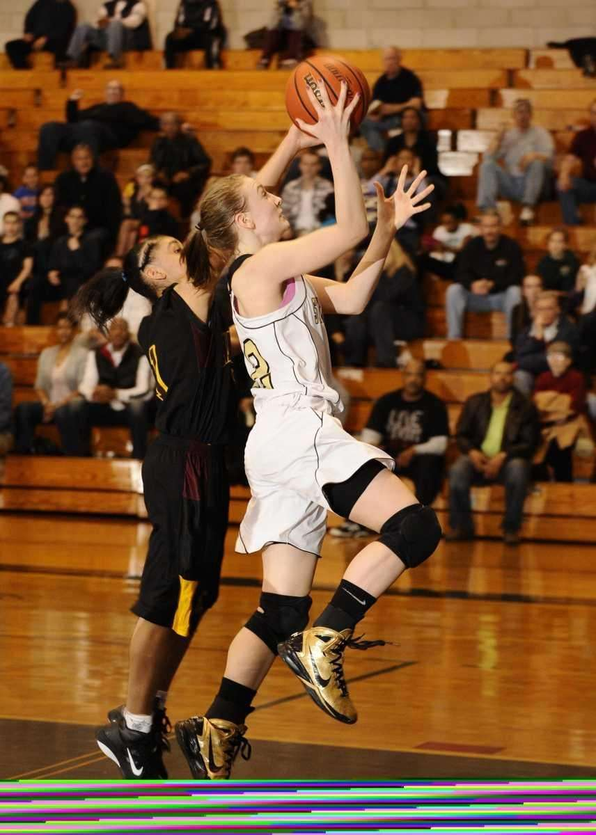 St. Anthony's Rebecca Musgrove scores and is fouled