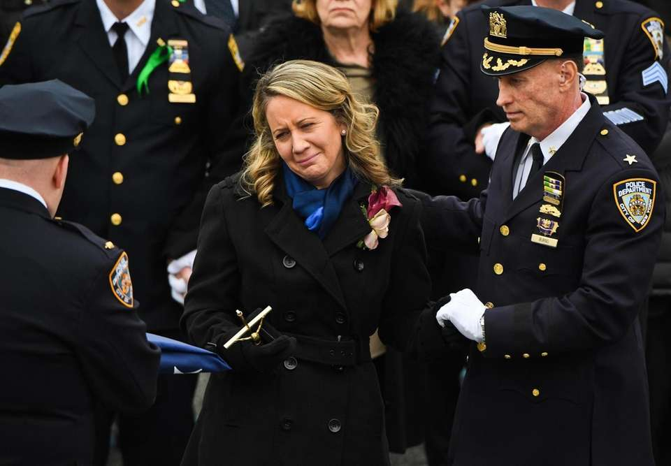 Leanne Simonsen is presented the memorial flag in