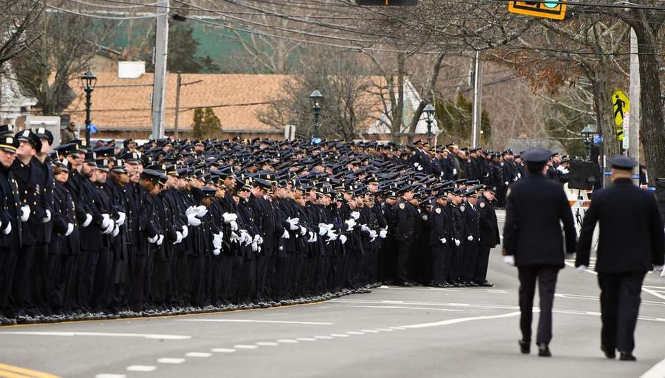 NYPD officers gather at the funeral for NYPD