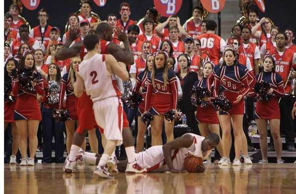 Stony Brook cheerleaders and fans react to the