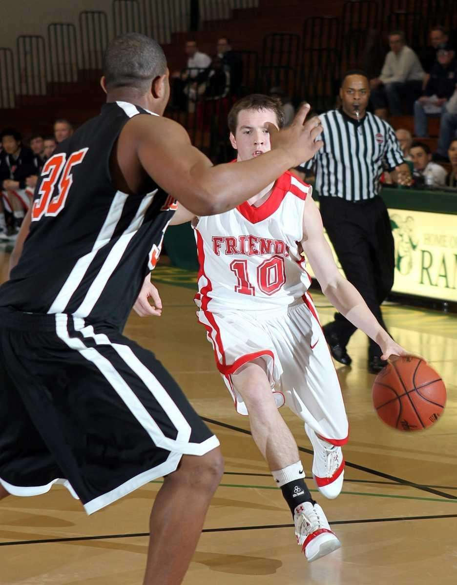Friends Academy's T.J. Hefele drives into the paint