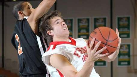 Friends Academy's Kellan Sehring drives to the basket