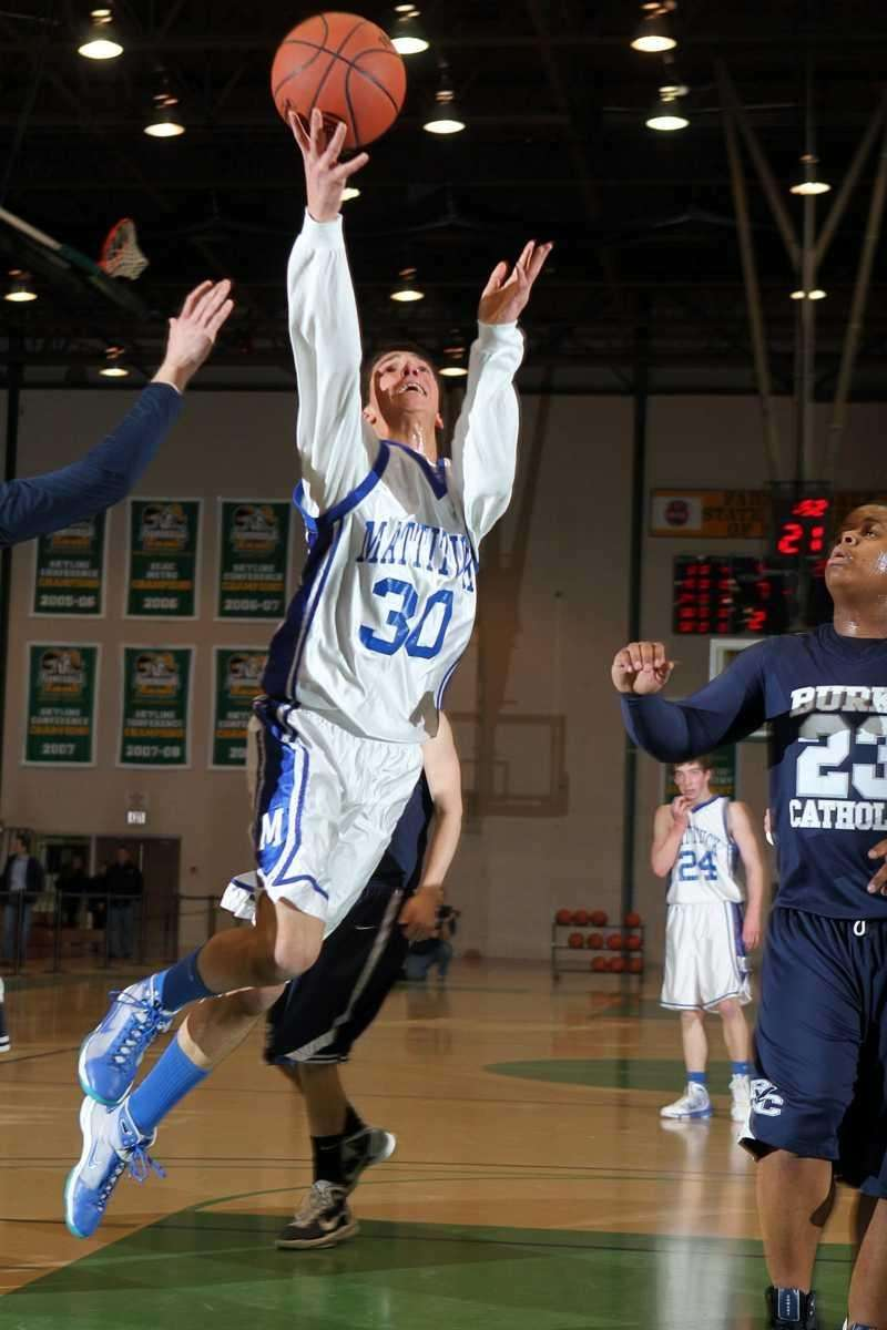 Mattituck's Cody Huntley takes a scoop layup in