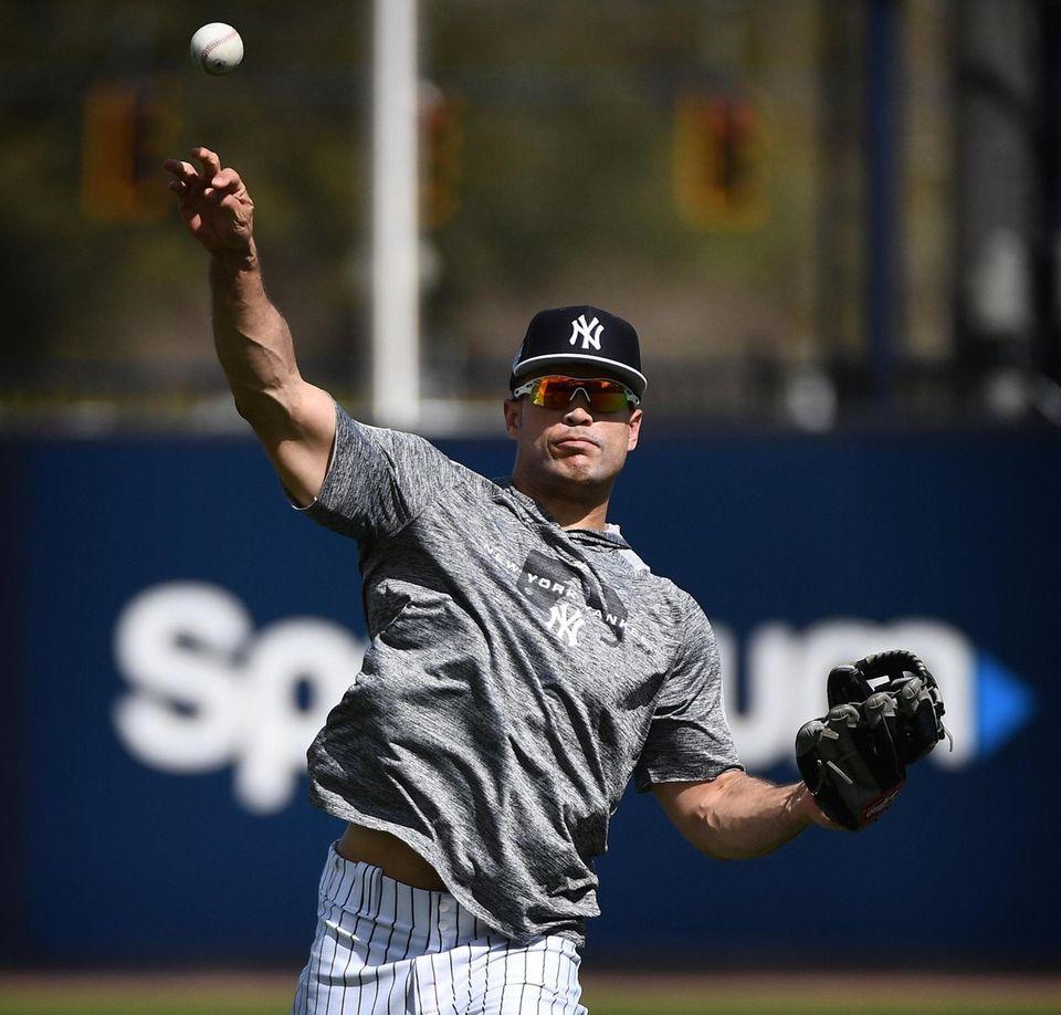 New York Yankees Giancarlo Stanton throws during Spring