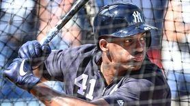 Yankees third baseman Miguel Andujar takes batting practice