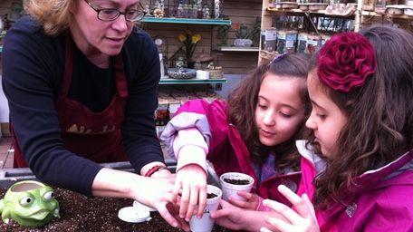Hicks Nurseries employee Angela Fischer teaches Nicole and