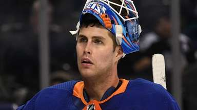 Islanders goaltender Thomas Greiss looks on against the