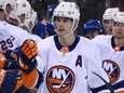 Islanders players congratulate defenseman Thomas Hickey after he
