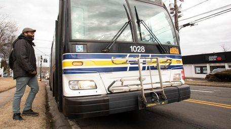 Aaron Watkins-Lopez, of Stony Brook, takes the bus