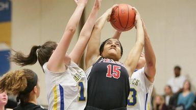 Pierson's Aziza El (15) grabs a rebound away