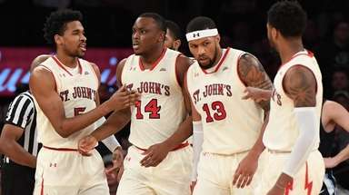 St. John's guard Justin Simon, guard Mustapha Heron,