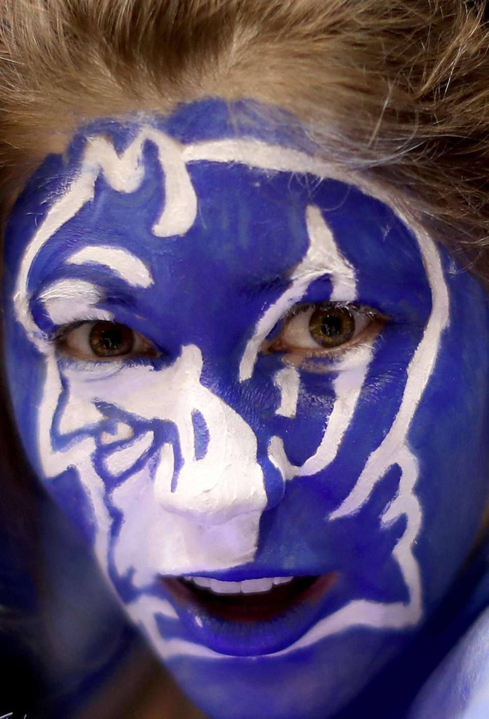 Fans of the Duke Blue Devils watch on