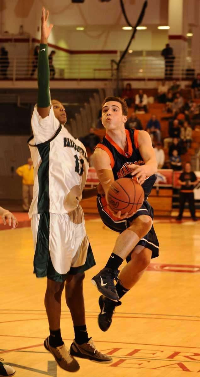 Manhasset's Anthony Amitrano shoots past Harborfields's Matt McLeod