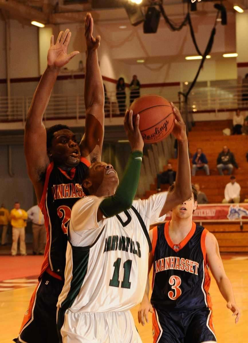 Harborfields' Matt McLeod shoots past Manhasset's Gary Tibbs