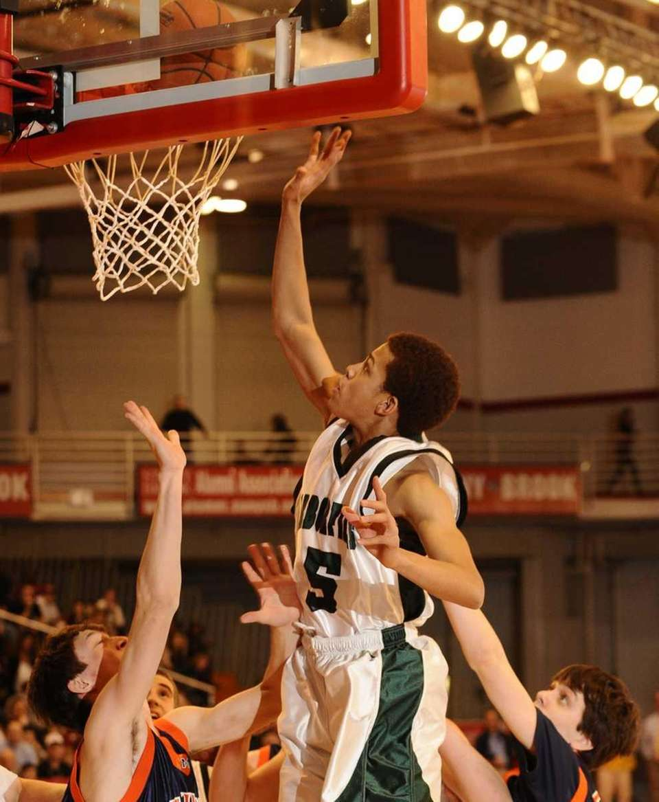 Harborfields' David Ba goes up for two points