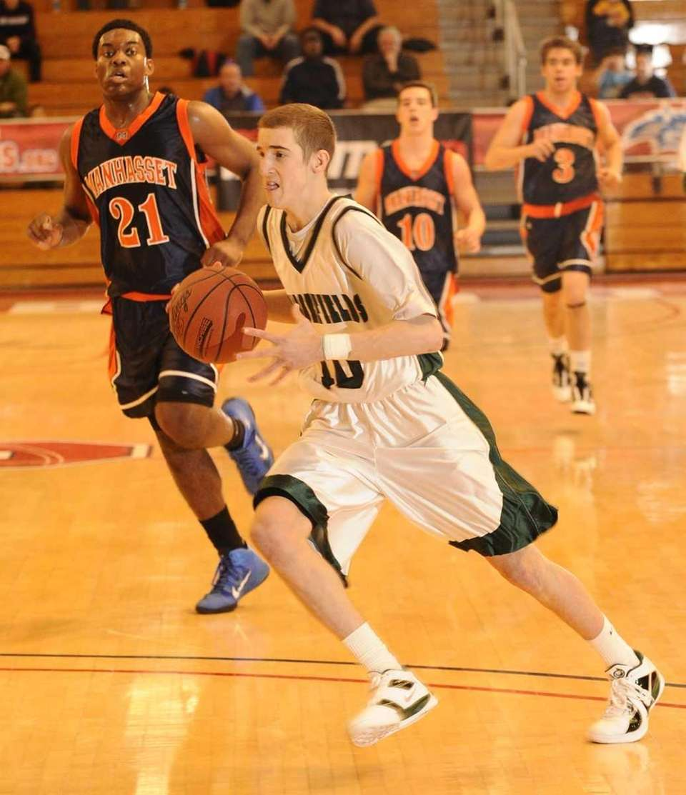 Harborfields' Lucas Woodhouse drives to the basket against