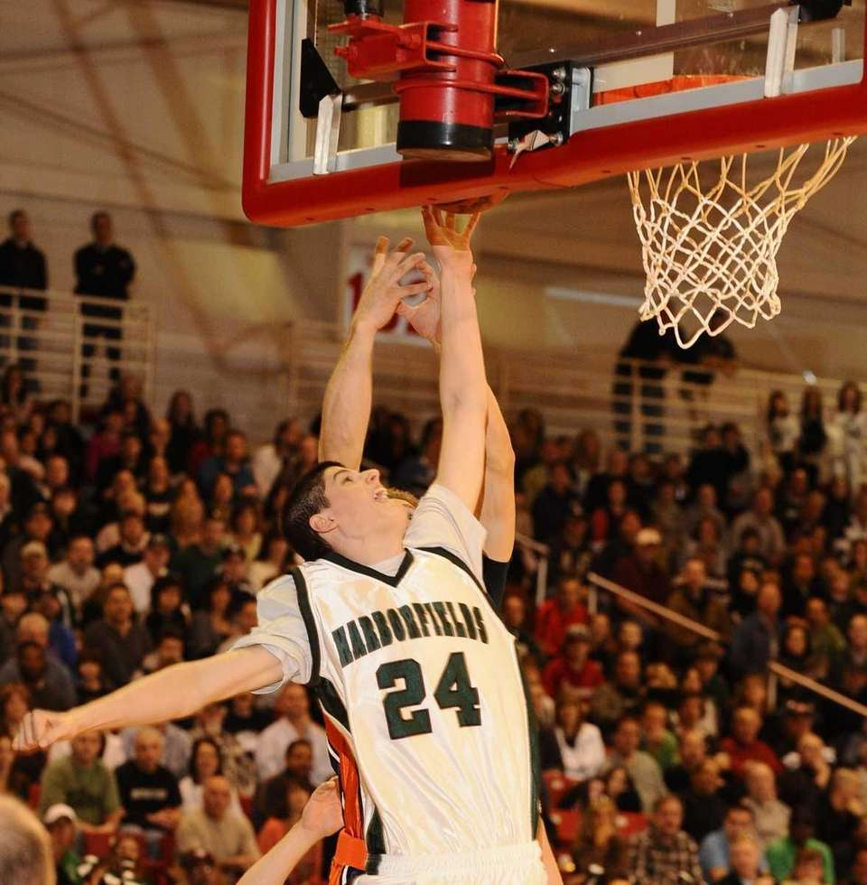 Harborfields' Justin Ringen goes up for two points