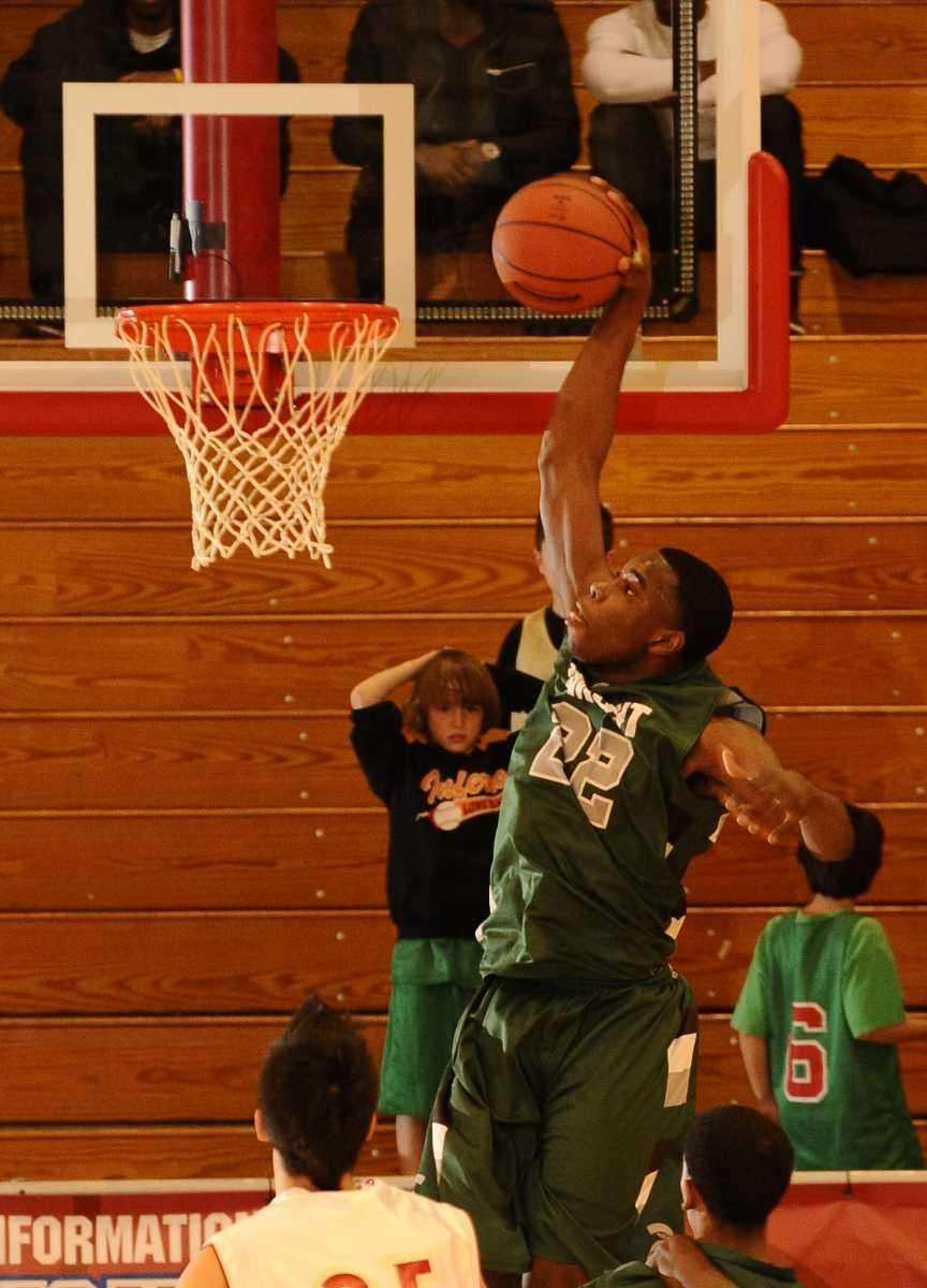 Elmont's Anthony Elechi scores against Half Hollow Hills