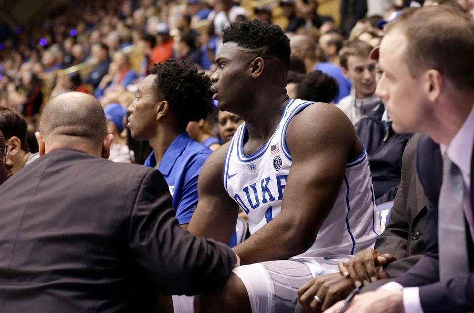 Duke's Zion Williamson (1) is attended to on