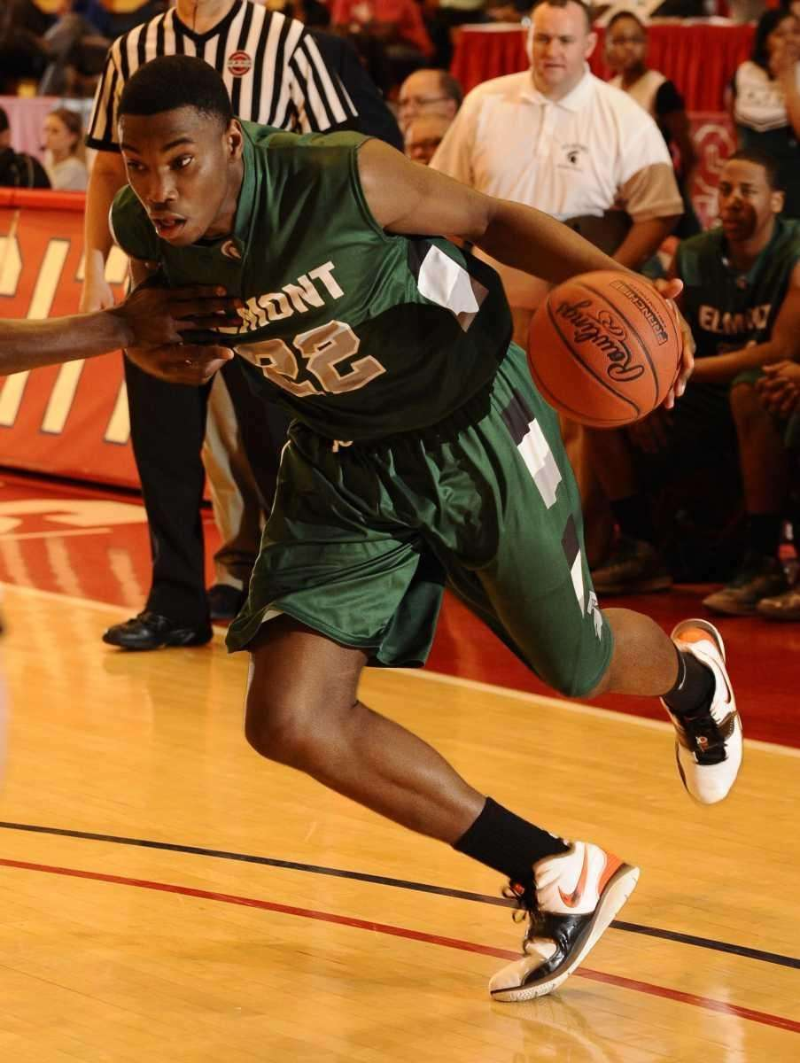 Elmont's Anthony Elechi drives to the basket against
