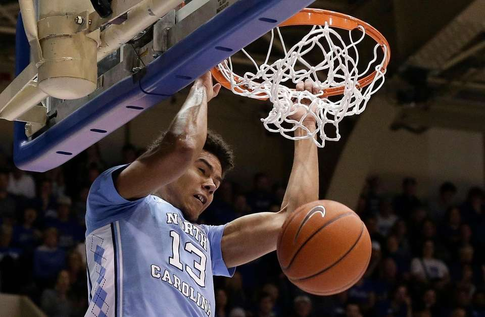 North Carolina's Cameron Johnson dunks against Duke during