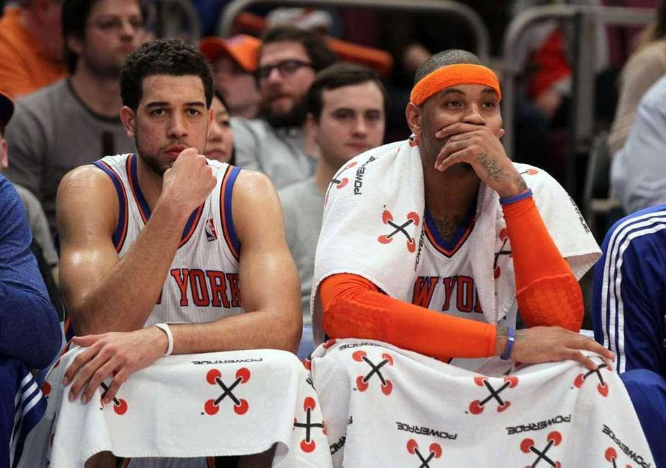 Landry Fields #6 and Carmelo Anthony #7 of