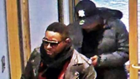 Police have released a surveillance image of two