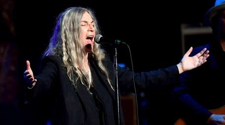 Patti Smith performs at a benefit concert on