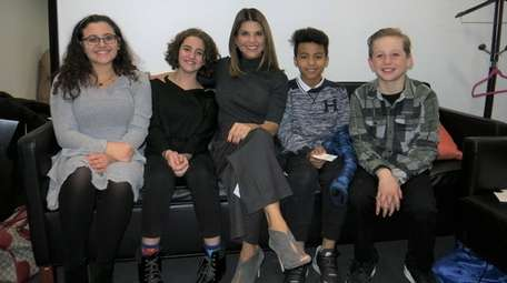 Actress Lori Loughlin, center, with Kidsday reporters, from