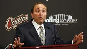 NHL commissioner Gary Bettman speaks to reporters in