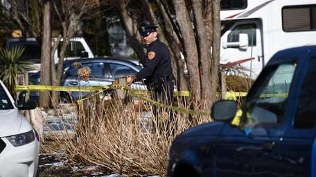 Suffolk County police put up crime scene tape