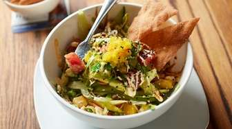The ahi-tuna poke bowl is threaded with wisps