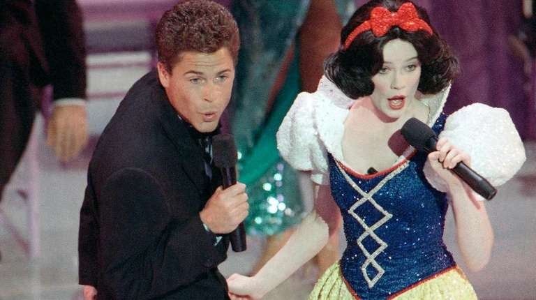 Rob Lowe croons a tune with Snow