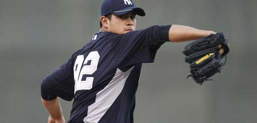 Lefthander Manny Banuelos pitches for the Yankees in