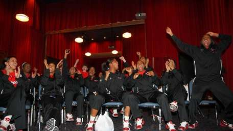 The St. John's women's team reacts to selection
