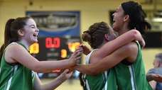 Sydney Moore of Farmingdale, right, gets congratulated by