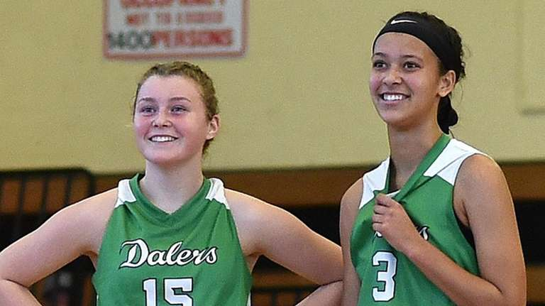 Kelly Bergersen #15, left, and Sydney Moore #3